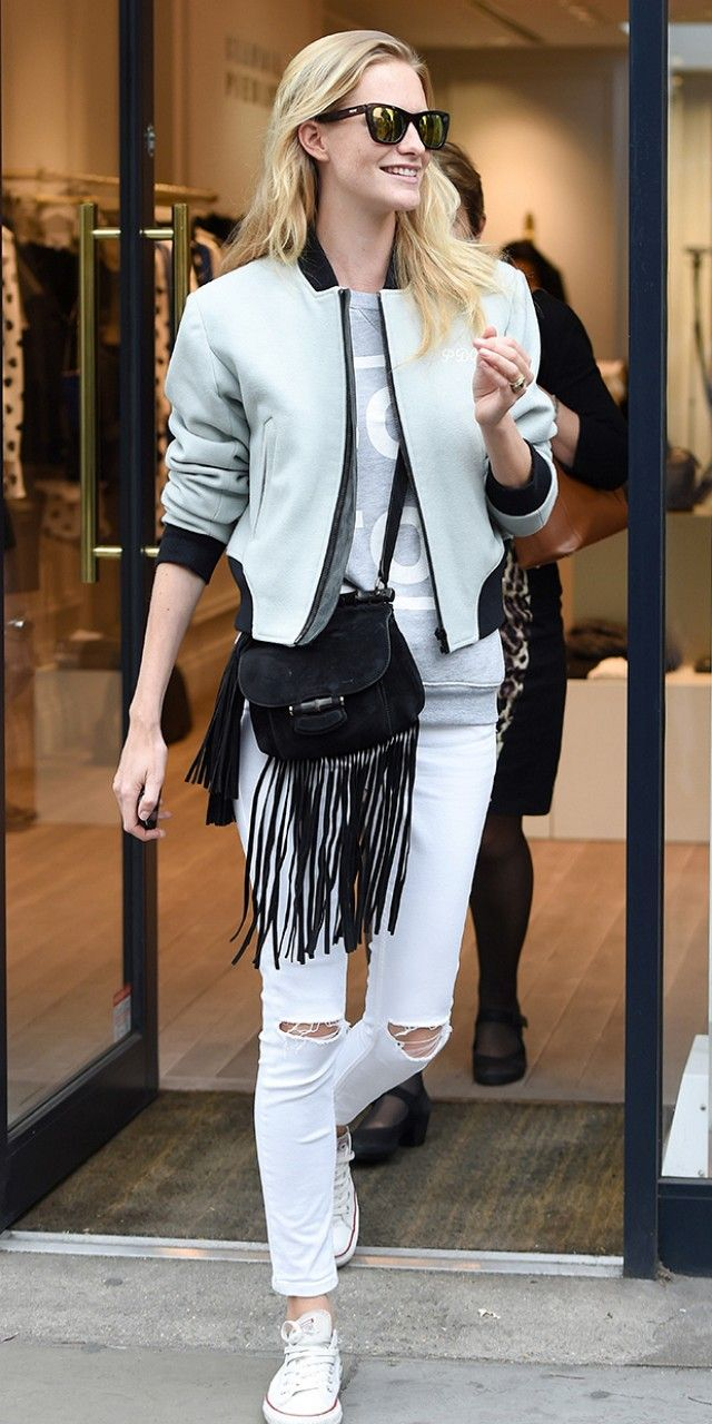 poppy delevingne, fringe bag ,varsity jacket, baseball jacket, distressed white denim
