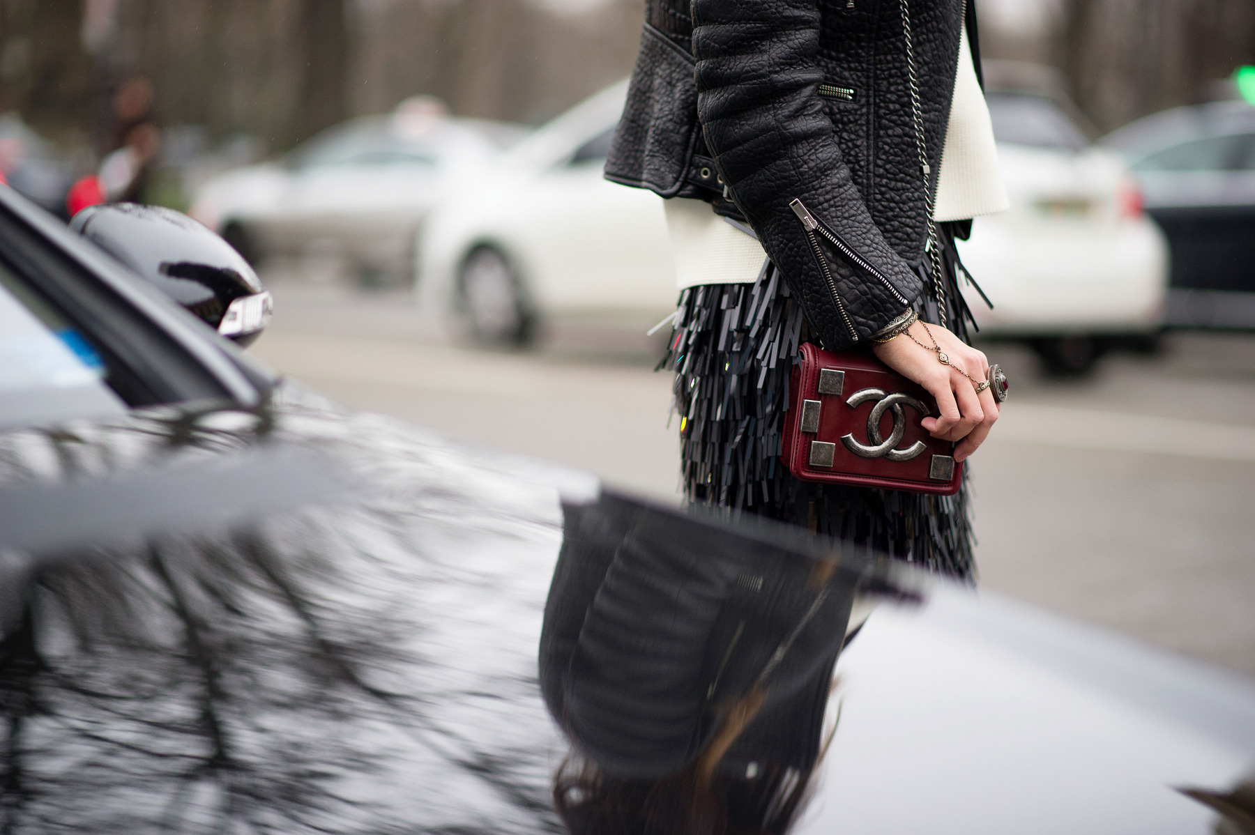couture-stree-style-1-35.nocrop.w1800.h1330, fringe skirt, black leather moto jacket, chanel bag, mini bag, black and white, fall, winter, holiday