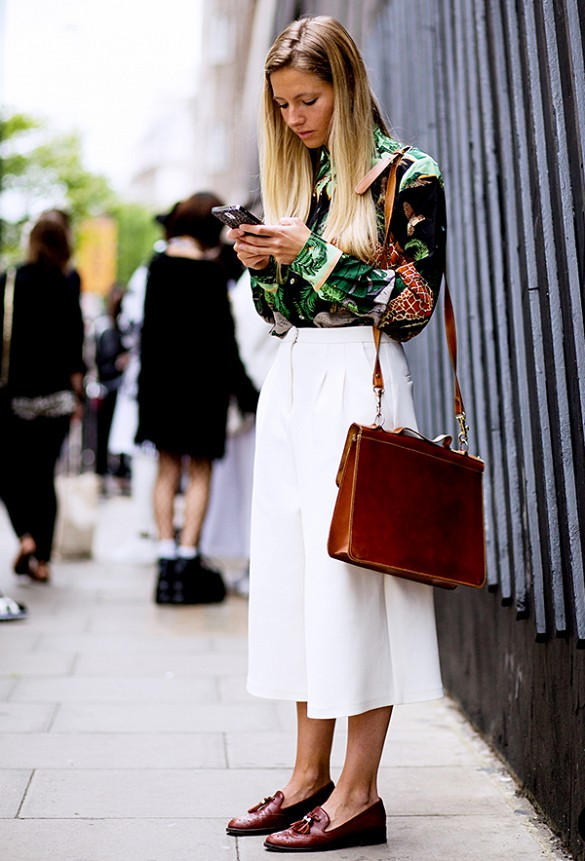 white wide leg culottes, printed blouse, loafers, briefcase