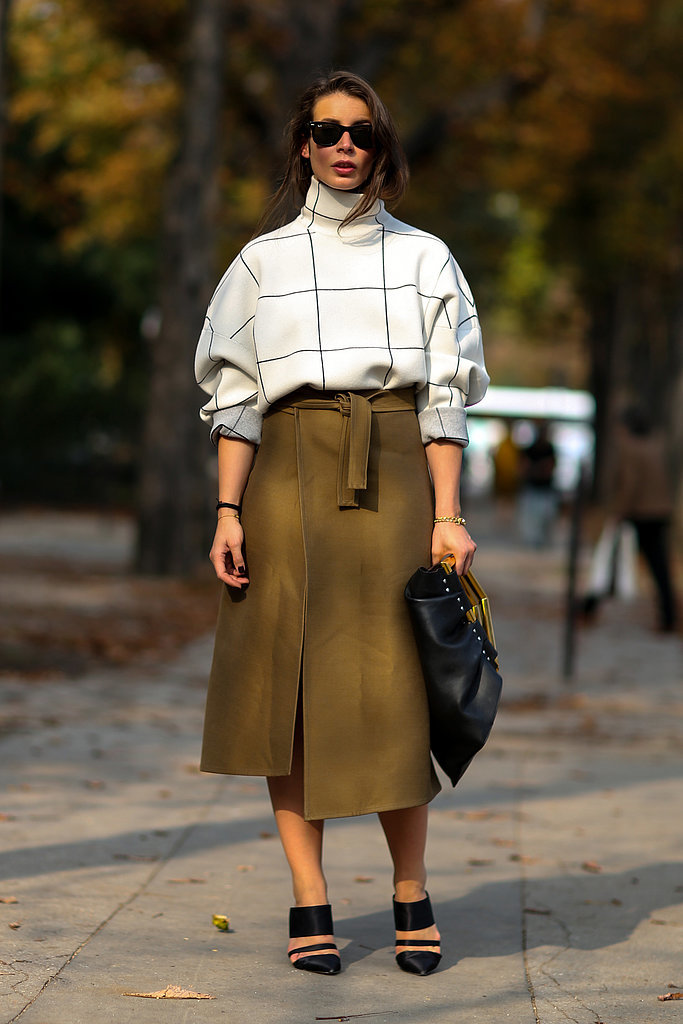 PFW-Street-Style-Day-2-1, wrap skirt, olive green, military green, skirt, turtleneck, prints, printed sweater, sweaters and skirts, windowpane prints, mules, clutch, sunglasses