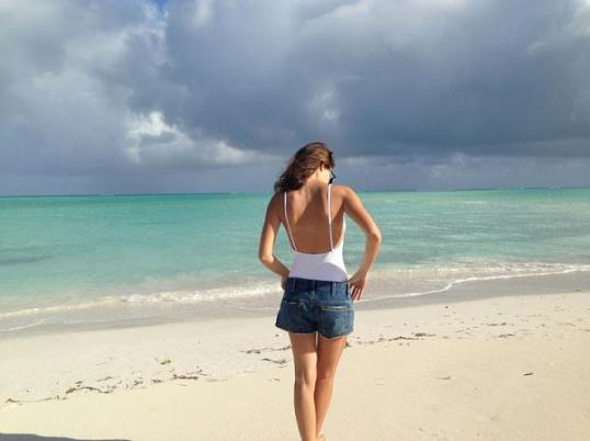 maria duenas jacobs, beach vacation, cutoffs, white one-piece swimsuit, beach, jetsetter