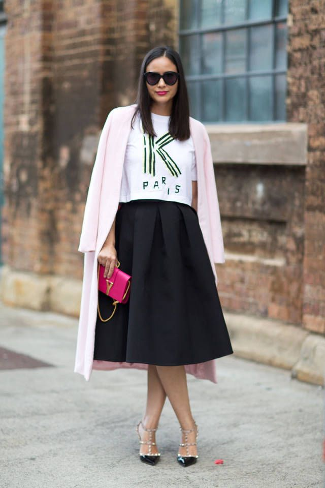 black midi skirt, graphic tee, fall pastels, pastels, pastel pink, pastel coat, neon, neon bag, ysl hot pink bag, sunglasses, valentino studded t-strap heels