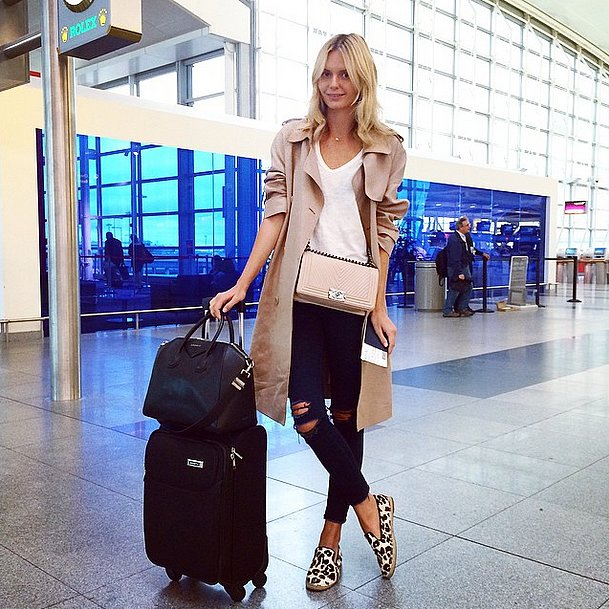 what to wear to fly, airport outfit, airport-jetsetter-travel-black-distressed-denim-trench-coat-luggage-via-tuulavintage-instagram