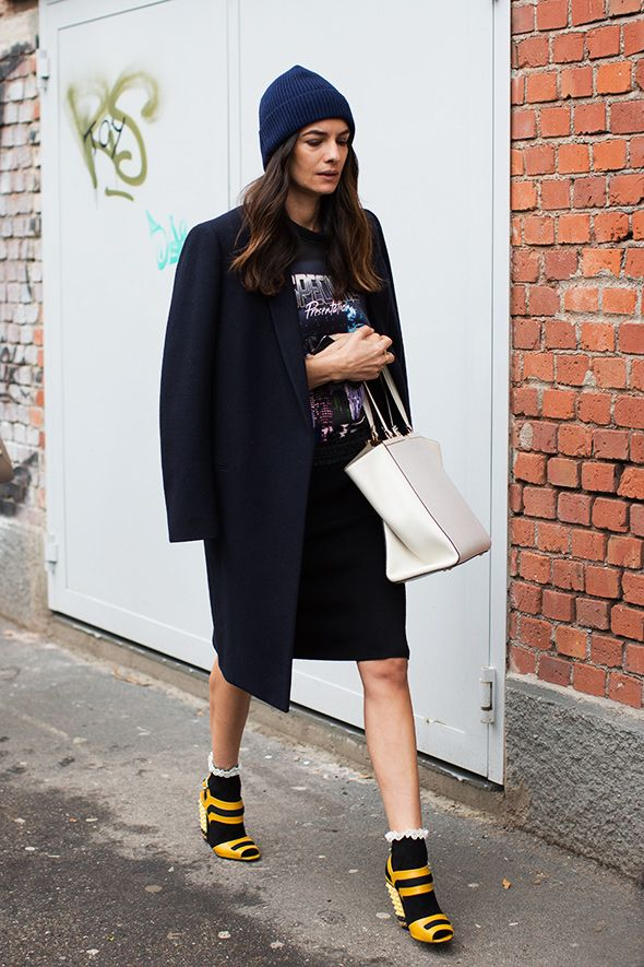 black-midi-skirt-sandals-and-socks-graphic-tee-beanie-black-coat-white-bag-via-the-sartorialist