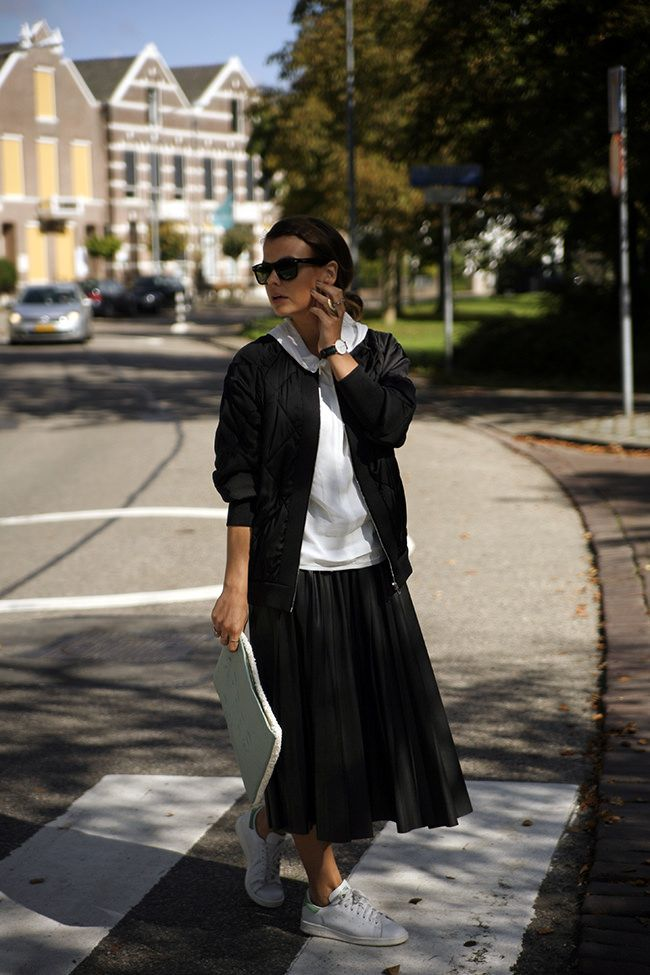 black-pleated-midi-skirt-white-sweatshirt-hoodie-black-baseball-jacket-adidas-sneakers-stan-smiths-black-and-white-clutch-fall-via-ift.tt