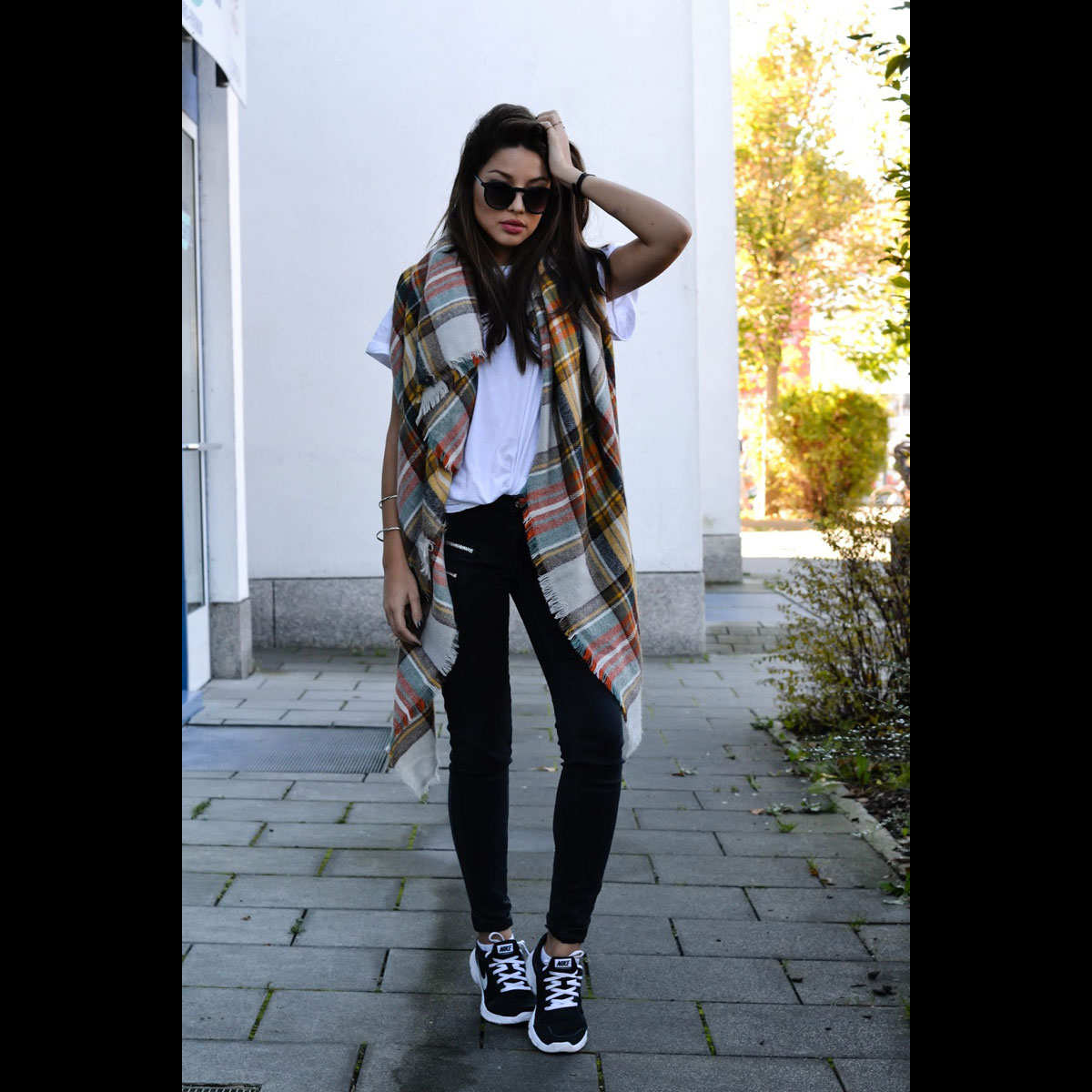 blanket-scarves-cocoaroundthecorner-plaid-sneakers-black-jeans-tee-via-coco-around-the-corner-the-cut