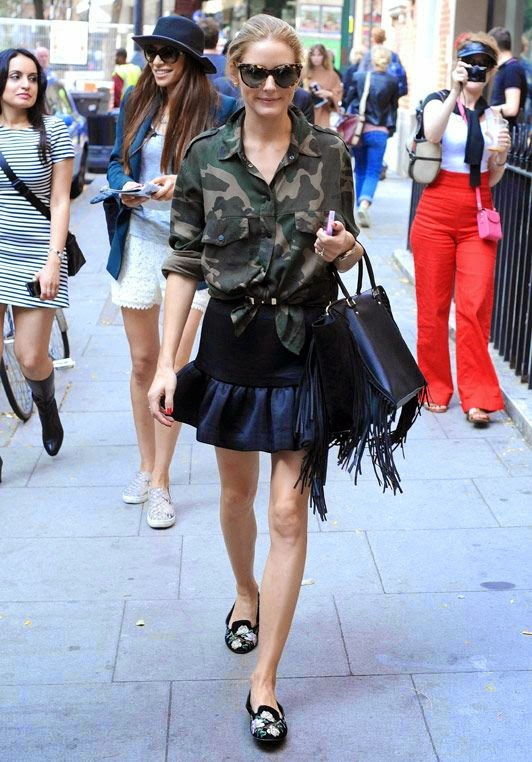 via oliviapalermofashionstyle.tumblr.com, peplum skirt, ruffle hem, ruffle mini skirt, black skirt, knotted shirt, camo shirt, slipper loafers, black bag, tortoise sunglasses, olivia palermo, style setters, fall, fringe, fringe bag