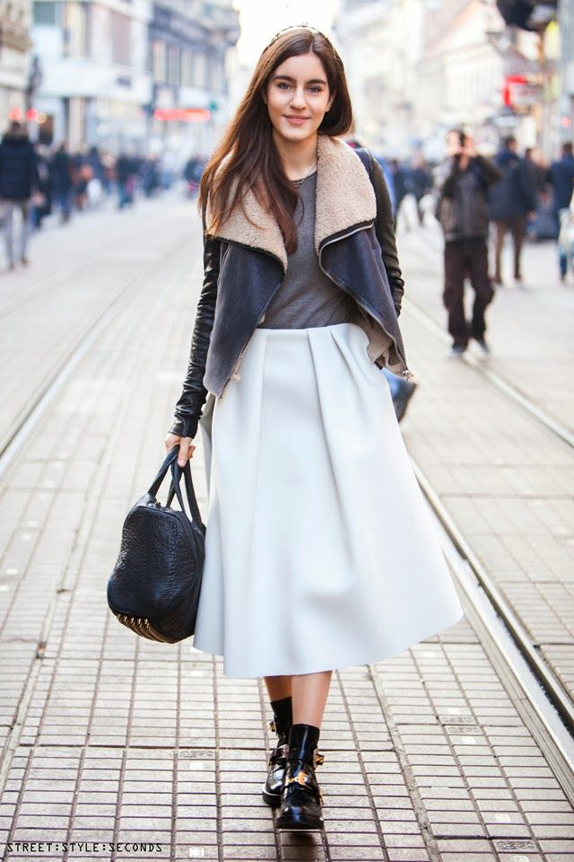 white full midi skirt, grey tee, black bag, buckled black booties, ankle boots, shearling black moto jacket