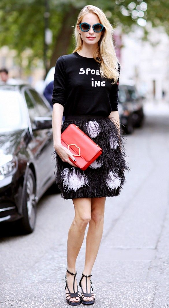 feather-mini-skirt-statement-word-sweater-poppy-delevingne-red-clutch-sandals-via-whowhatwear