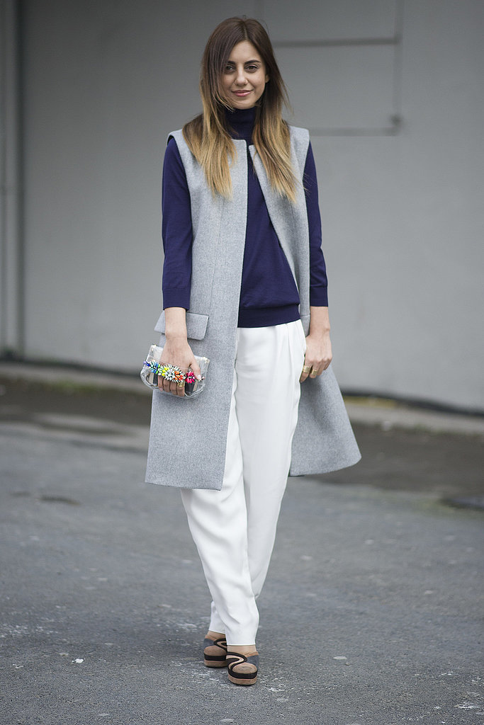 long-vest-fall-whites-turtleneck-clutch-menswear-grey-sandals-socks-via-getty-via-popsugar, wide leg pants