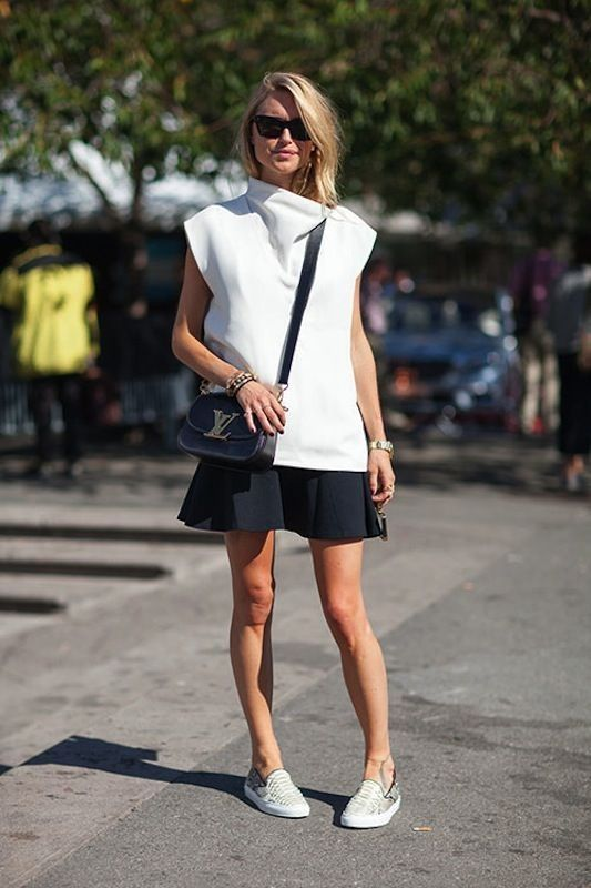 sneakers-and-skirts-black-and-white-summer-spring, ysl purse, crossbody purse, mini bag, sunglasses, black mini skirt, flippy skirt, white turtleneck cowl neck top, sleeveless turtleneck, slip-on sneakers, printed sneakers, sneakers and skirts