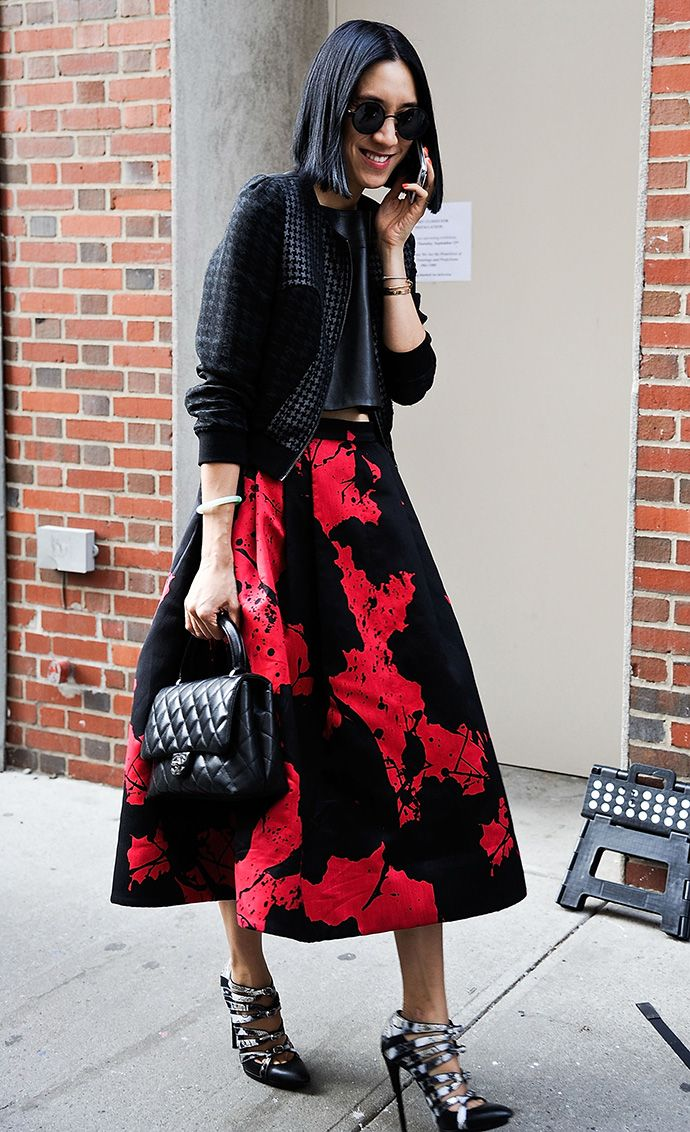 artsy print, splatter paint print, cropped midi jacket, cropped baseball jacket, quilted black chanel purse, eva chen, crop top, fall crop tops, caged heels, black and white heels, tibi-red-and-black-printed-artsy-prints-midi-skirt-houndstooth-baseball-jacket-chanel-quited-purse-edy-moto-ankle-boots-boots-and-skirts-printed-baseball-jacket-houndstooth-via-iwantbigcloset.tumblr.com-via-getty