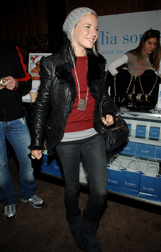 sienna miller, sundance, leather moto jacket, shearling, red sweater, jeans, beanie, winter weekend outfit