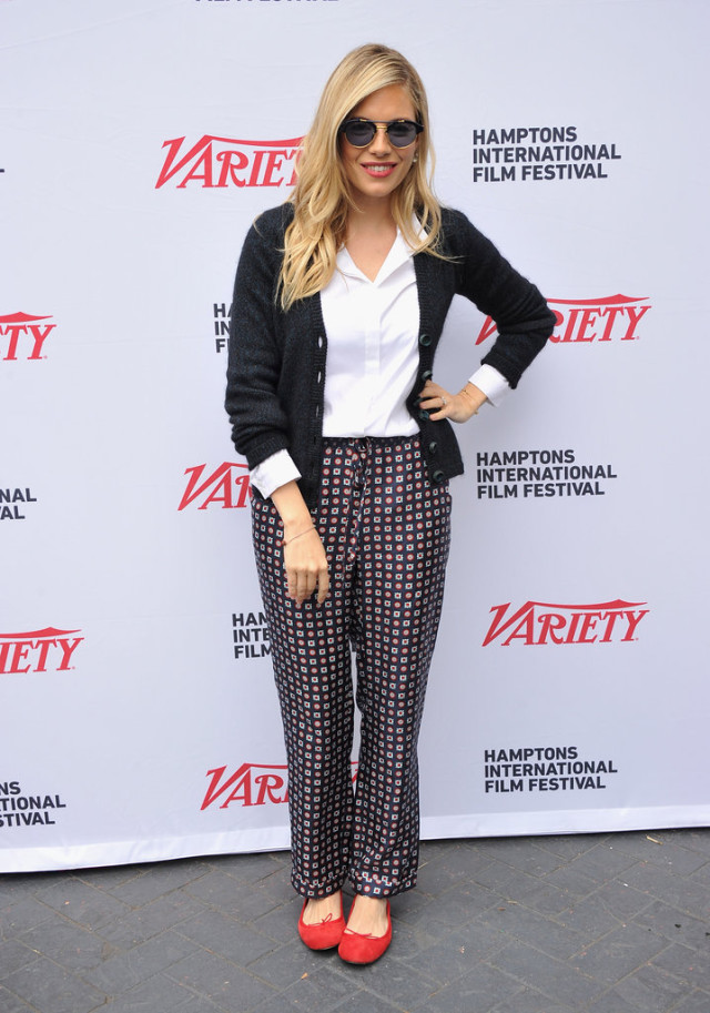 sienna miller, cardigan, red ballet flats, printed pants, white oxford, pajama pants, getty