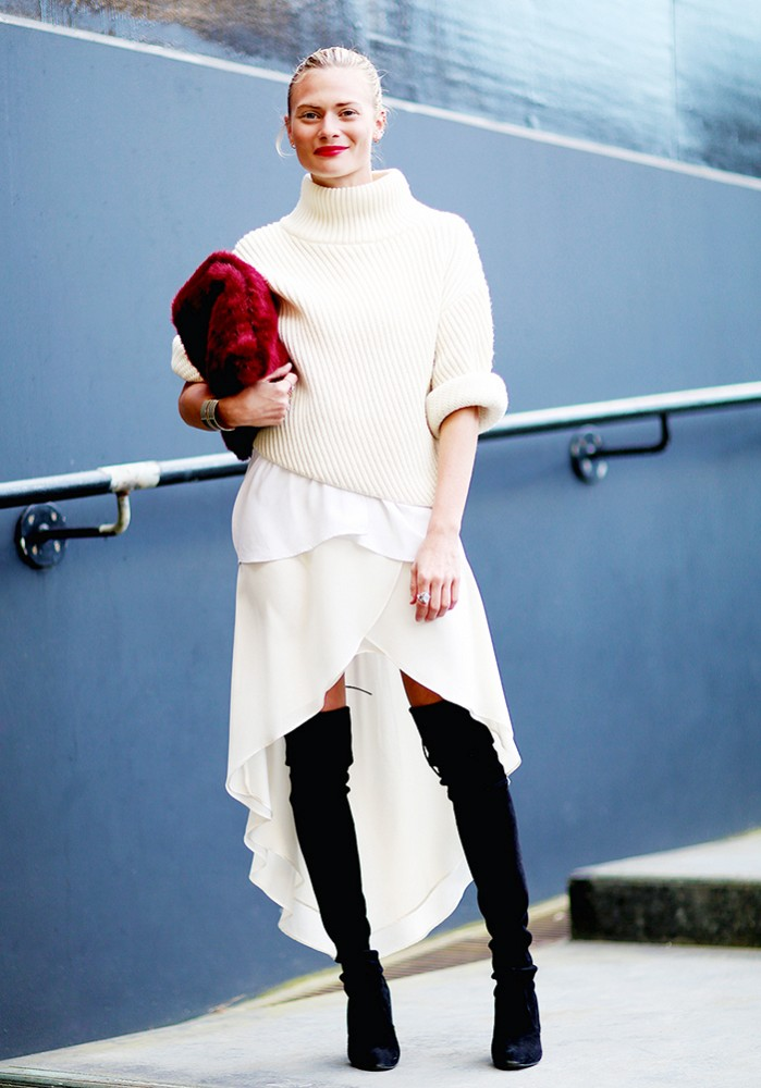 black and white, asymmetrical hankerchief skirt, ruffled high low skirt, ivory all white monochromatic, red fur bag, furry bag clutch, white turtleneck sweater chunky knit, over the knee thigh high boots, black and white, ruffled wrap skirt, hankerchief hemline