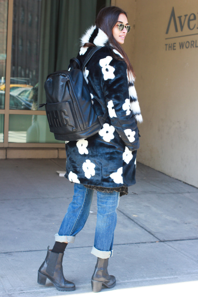 how to roll your jeans, denim styling, jeans, daisy print fur coat, backpack, boots, socks