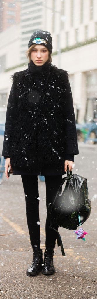snow outfits, what to wear in a snowstorm, winter outfit, nyfw-models-backpack-all-black-beanie-winter-layering-freezing-snow-via-popsugar