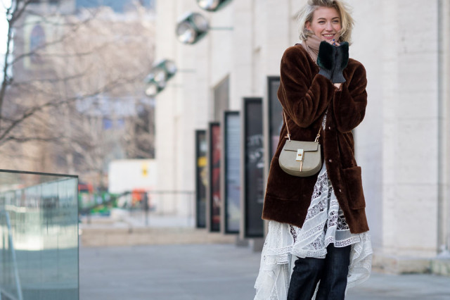 nyfw-winter-layers-freezing-elle-white-lace-dress-summer-dresses-winter-jeans-dresses-over-pants-fur-coat-teddy-bear-fur-model-style-fur-gloves