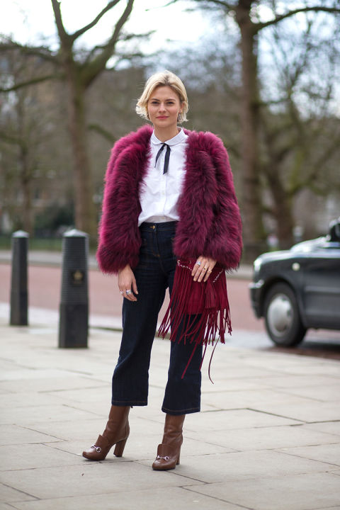 cropped flares, booties, tie neck blouse, bow neck blouse, fur jacket, colored fur, fur bomber, fringe bag, burgundy, peter pan collar, flare jeans, 70s boho fall outfits harpersbazaar.com