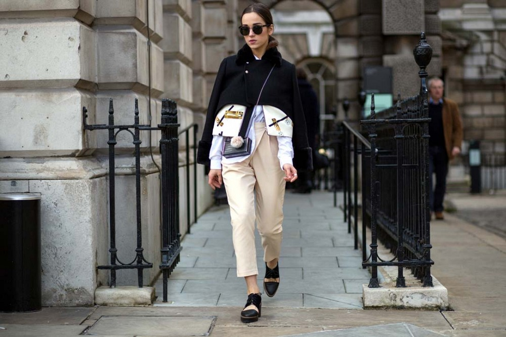 lfw-khakis-cropped-pants-oxfords-jacket-on-shoulders-via-thestyleograph