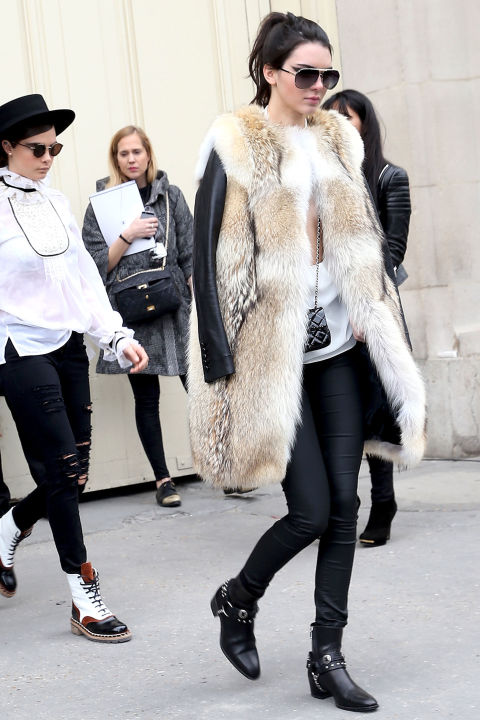 kendall-jenner-black-skinnies-moto-boots-fur-vest-jacket-model-style-winter-fall-via-getty