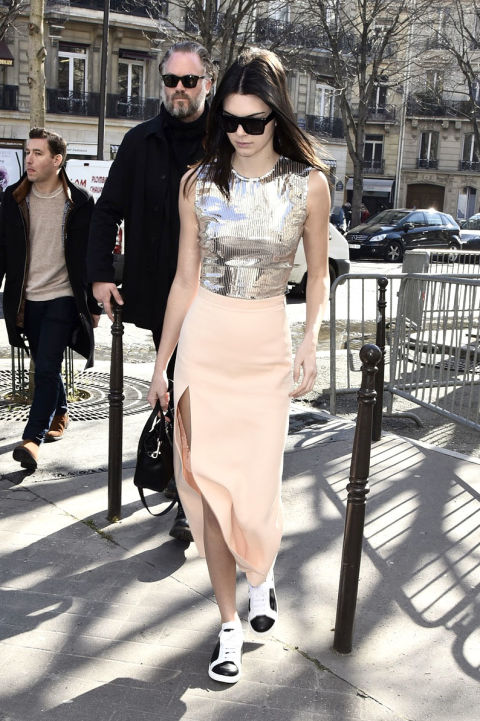 kendall-jenner-blush-midi-skirt-pastels-sneakers-and-skirts-shiny-metallic-cro-top-silver-spring-going-out-night-out-trends--via-cosmo