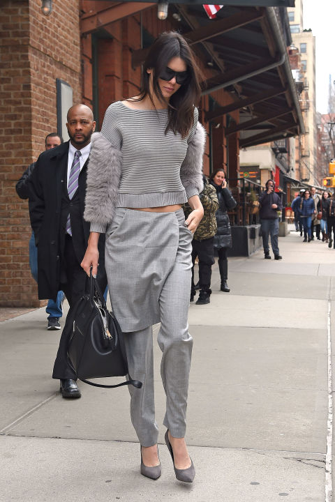 kendall-jenner-grey-all-gray-grey-monochromatic-apron-pants-skirts-over-pants-crop-top-spring-trends-model-style--via-getty