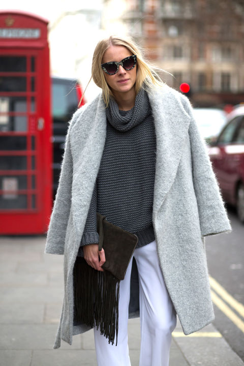 white-pants-grey-sweater-turtleneck-sweater-chunky-sweater-grey-coat-coat-on-shoulders-grey-and-white-fringe-clutch-via-hbz