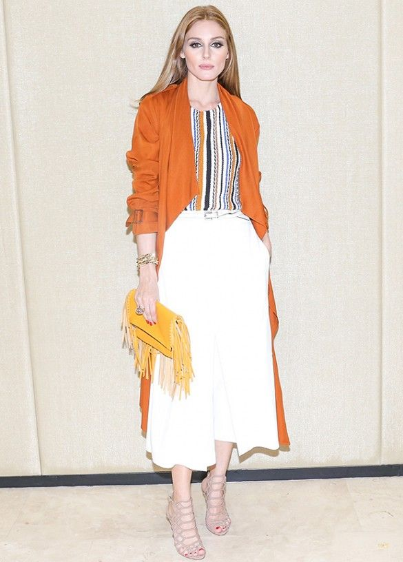 white culottes, orange duster coat, cage booties, fringe bag, striped shirt, belt, olivia palermo