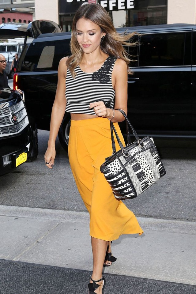 jessica-alba-myellow-midi-skirt-striped-crop-top-black-heels-via-hbz
