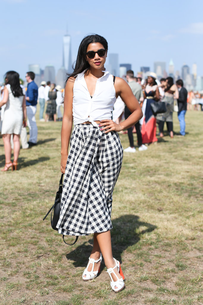 Hannah-Bronfman, gingham midi skirt, sleeveless button up shirt, white sandals, knotted shirt, black bra, governor's ball, summer party, summer weekend