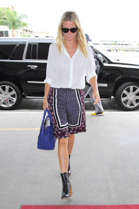 gwyneth-paltrow-printed-shorts-summer-booties-white-blouse-via-getty