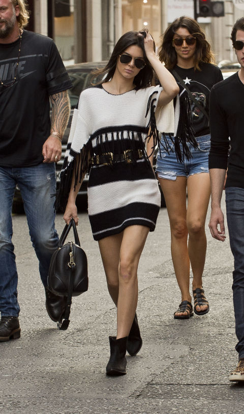 kendall-jenner-black-and-white-sweater-dress-fringe-belted-ankle-booties-summer-booties-model-off-duty-style-via-getty