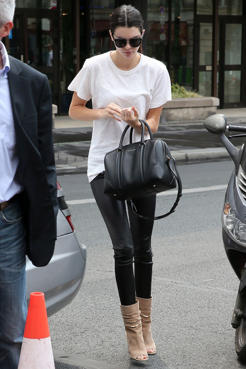 kendall-jenner-black-leather-skinnies-summer-booties-peep-toe-suede-tan-booties-white-tee-black-and-white-oversized-white-tee-model-off-duty-style-via-getty