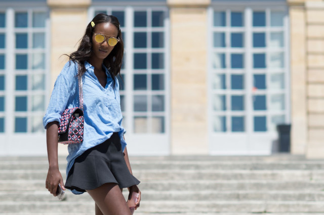 mens-oversized-oxford-blue-shirt-ruffle-peplum-hem-black-mini-skirt-sunglasses-summer-work-going-out-date-night-outfit-paris-couture-fashion-week-street-style-via-elle.com