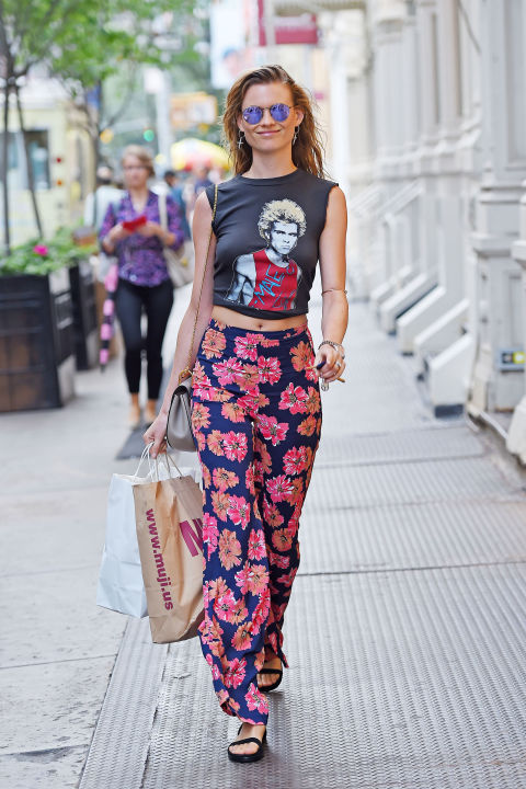 printed-silk-wide-leg-billowy-floral-pants-crop-top-graphic-vintage-rocker-tee-behati-prinsloo-model-off-duty-style-via-getty
