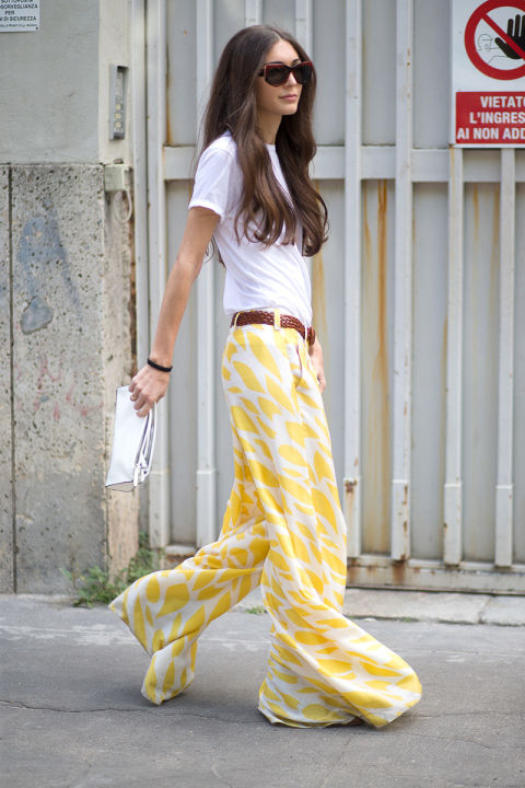 printed-wide-leg-pants-yellow-ikat-breezy-billowy-pants-woven-belt-white-tee-summer-work-outfit-via-hbz