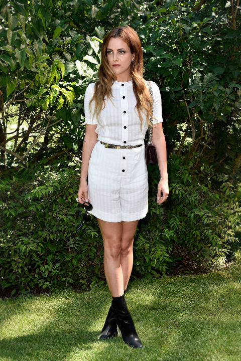 riley-keough-little-white-dress-belted-black-booties-summer-booties-paris-couture-fashion-week-via-getty