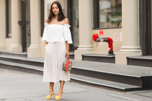white-off-shoulder-shirt-culottes-via getty