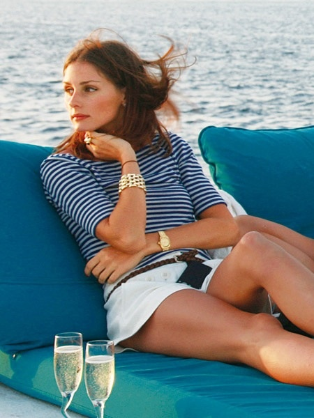 olivia palermo, yacht, sundress, boat, summer vacation, jetsetter style, vacation outfit, boat, sailing, white shorts, striped tee, summer outfit, preppy, nautical