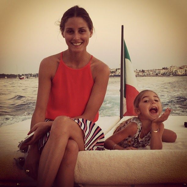 olivia palermo, yacht, sundress, boat, boating, summer vacation, jetsetter style, vacation outfit, boat, sailing, striped skirt, vacation, jetsetter, summer outfit