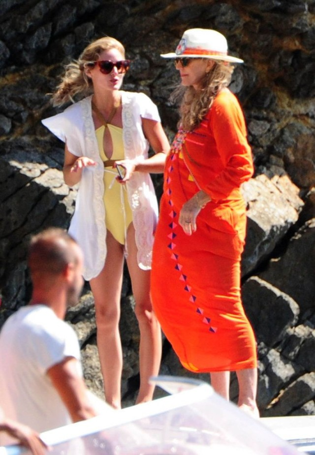 olivia palermo, yacht, sundress, boat, summer vacation, jetsetter style, vacation outfit, boat, sailing, coverup, cover up, cutout bathing suit, swimsuit, one piece, sunglasses
