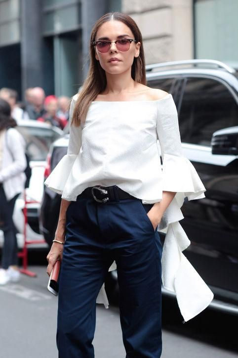 off-the-shoulder-shirt-navy-summer-work-outfit-ruffle-sleeves-via-glamour.com