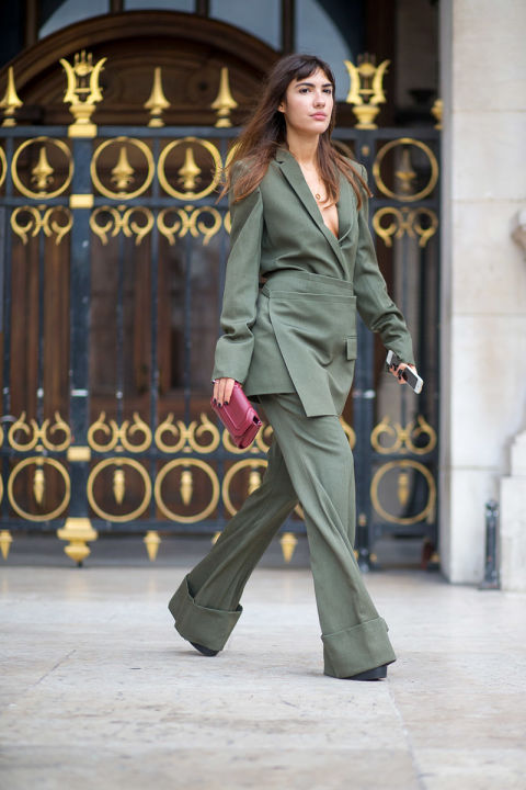 army green pants suit cuffed wrap skirt skirt over pants suit monocrhomatic jupmsuit hbz-street-style-paris-fashion week pfw-fall fashion