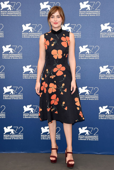 fall dresses-floral dress-fall florals-black florals-platform sandals-platforms-fall work outfit-wedding-dakota johnson-via getty