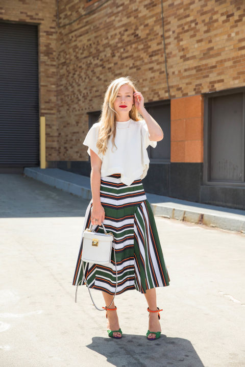 fall work outfit-white tee-fall colors-colorblocking-fall midi skirt-platforms-matching-orange-green-fall work outfit-transitional dressing-summer to fall-nyfw-cosmo
