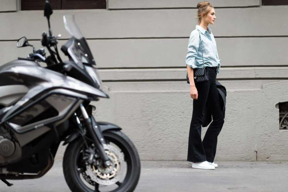 flares-chambray shirt white sneakers velvet pants-milan fashion week elle