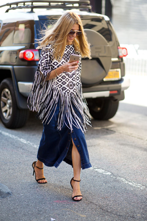 denim button front midi skirt, boho print fringe poncho, simple black sandals, fashion week milan fashion week fall fashion hbz