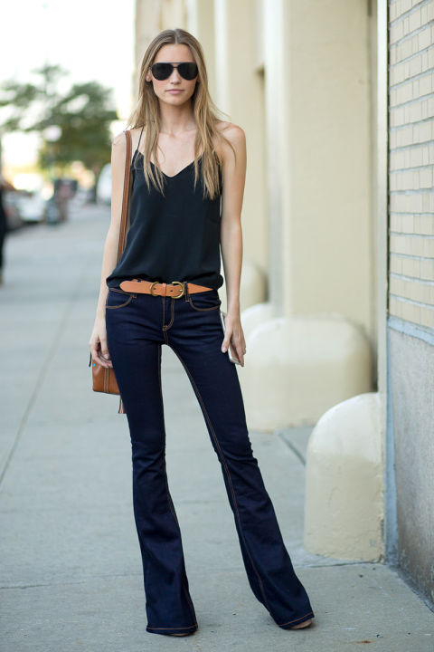 fall going out date night outfit, fall weekend outfit, flares flare jeans, belt, belted tan caramel accessories, black cami, simple, model off duty style, nyfw street style ss 2016 via harpersbazaar.com