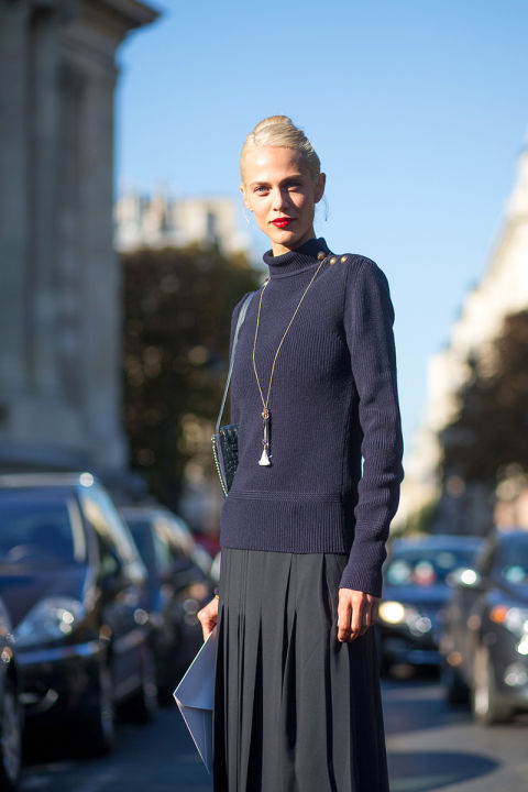navy turtleneck sweater, black pleated skirt, pendant necklace, paris fashion week,